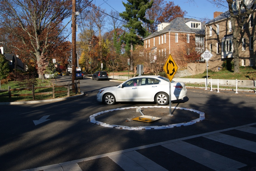 A car navigates one of the traffic circles shortly after their installation.