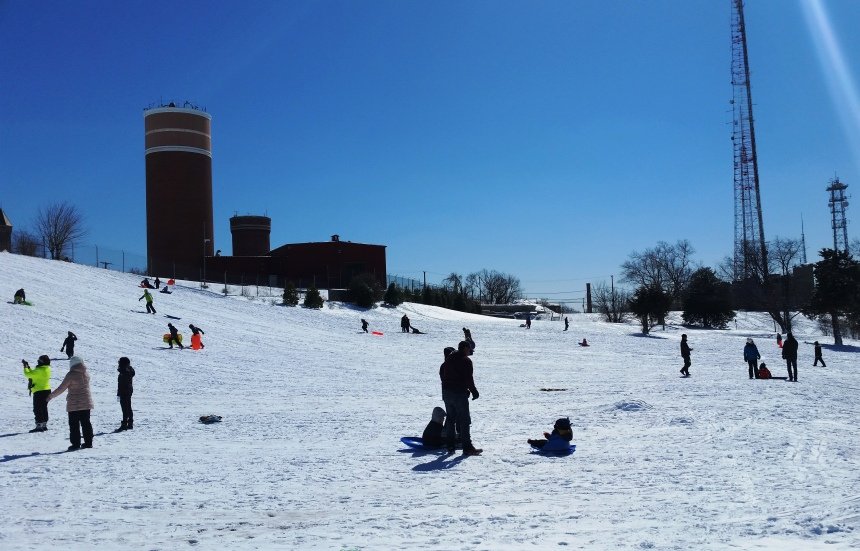 sledders with water and radio tower