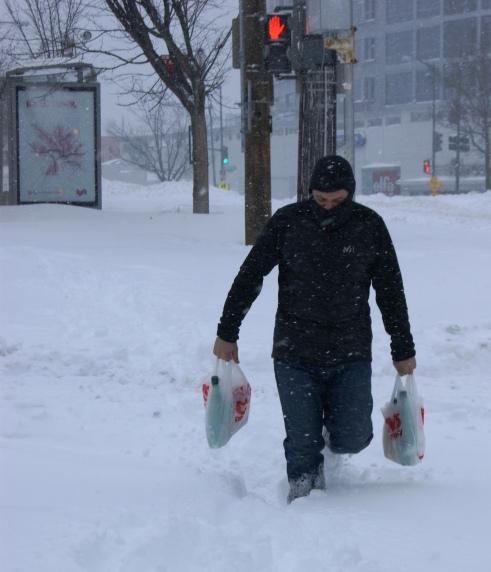 Tenley Village resident carrying home a few supplies.