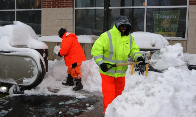 Metro crew cleared sidewalks around the Tenleytown-AU station.
